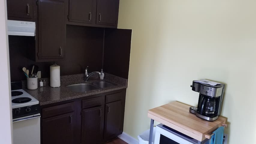 Kitchen includes apartment range, refrigerator.  Toaster, microwave, and coffee maker also included.