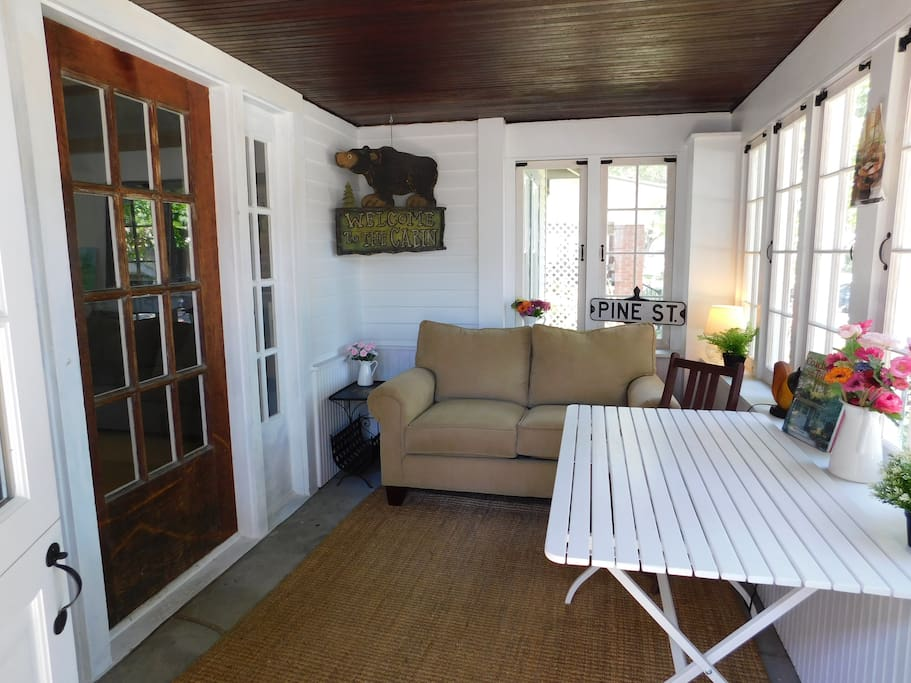 enclosed front porch, windows/screens