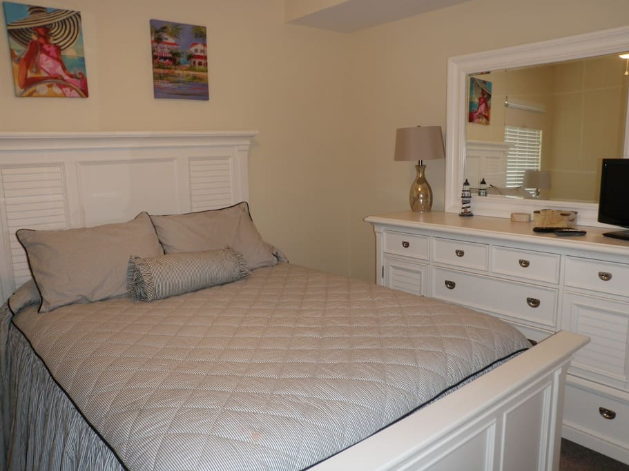 Guest bedroom with queen bed, flat screen TV and private bath.