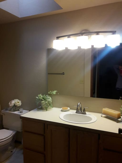 The full bathroom is kept very clean and shared by rooms 2 and 3.