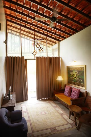 The family lounge of our Family Villa with 1 daybed, sofas, beanbags, air-conditioning, and television