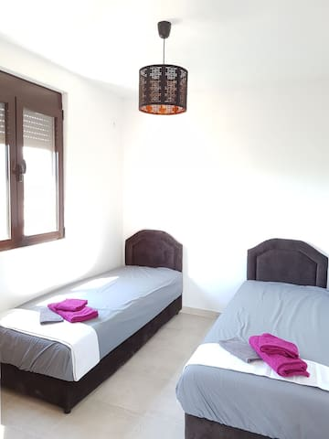 Bedroom 1: two single beds