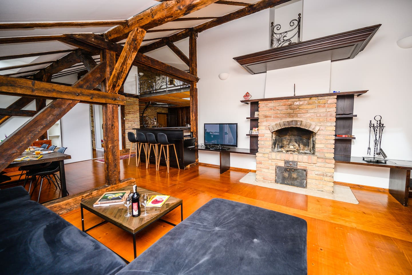 Spacious living room with huge fireplace perfect for enjoying winter days. :)