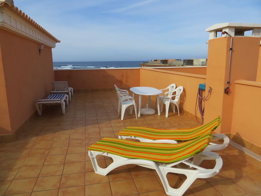 The private roof terrace with views of the sea