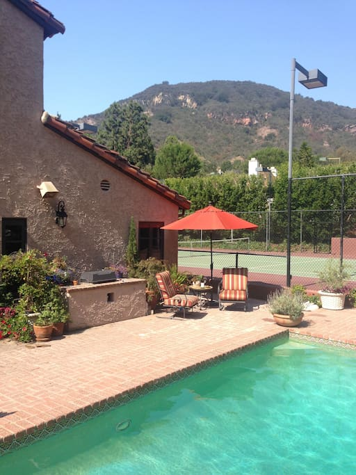 Summertime in our garden. Tennis anyone or perhaps a morning hike followed by a dip in the pool?