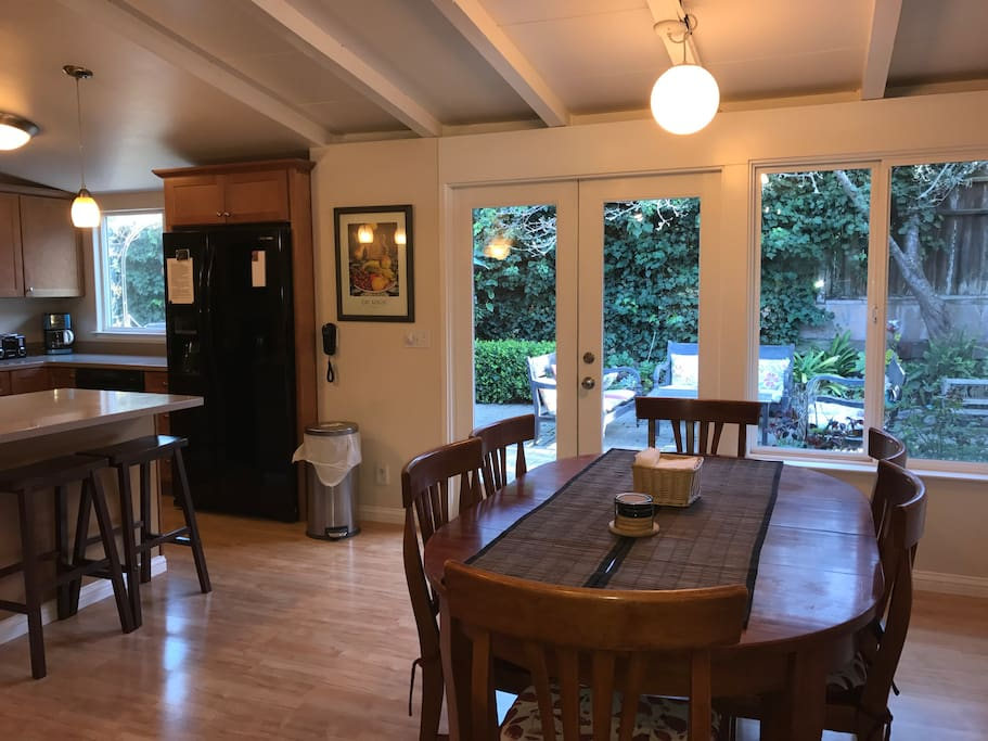 Open dinning room with seating for 6 with two extra bar stools