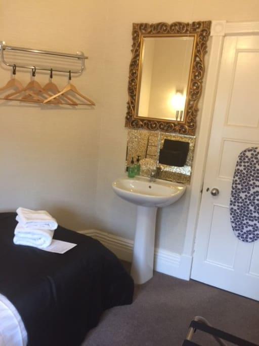 Single Room with basin, hospitality tray, linen and towels