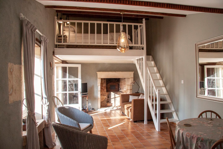 The mezzanine sits above a snug living room.