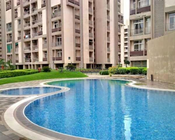 Fully Furnished Bedroom in 3 BHK Apartment