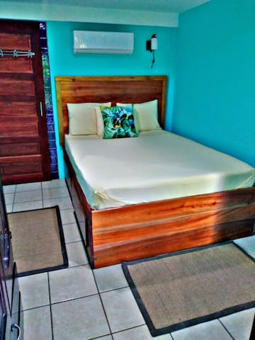 Mahogany queen bed with storage drawers & large wardrobe-guests say it's our most comfy mattress!