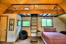 Awesome twin loft beds (2) with a window to look out and see the stars at night.