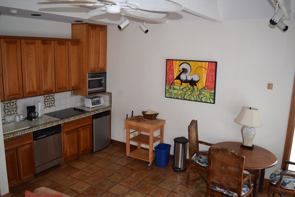 Kitchen includes a fridge, cook top, coffee maker, toaster-oven, and wine cooler