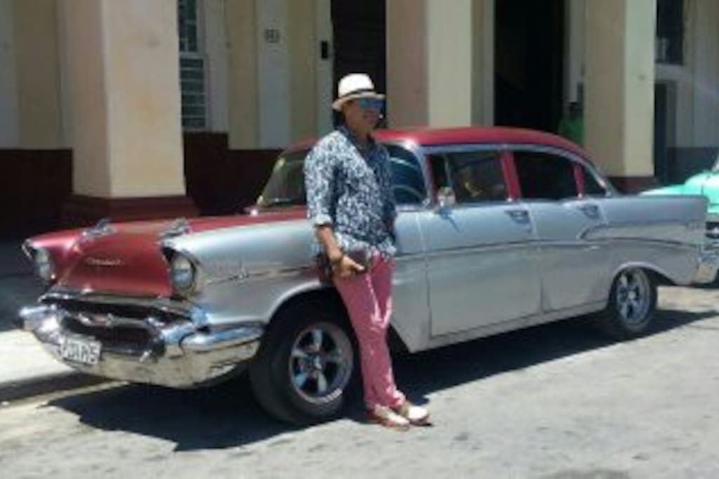 The Host and the classic car with air conditioning for your pick up at the airport,