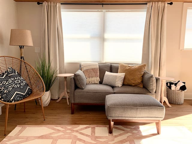 Comfy couch to relax after enjoying your day at the beach. Did we mention the beach is less than 100ft away?