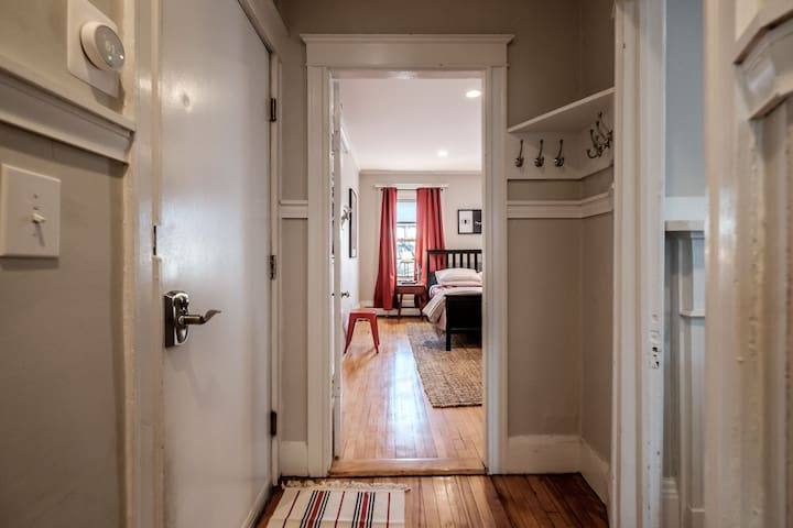 To your left once you enter you'll find the larger of the two bedrooms