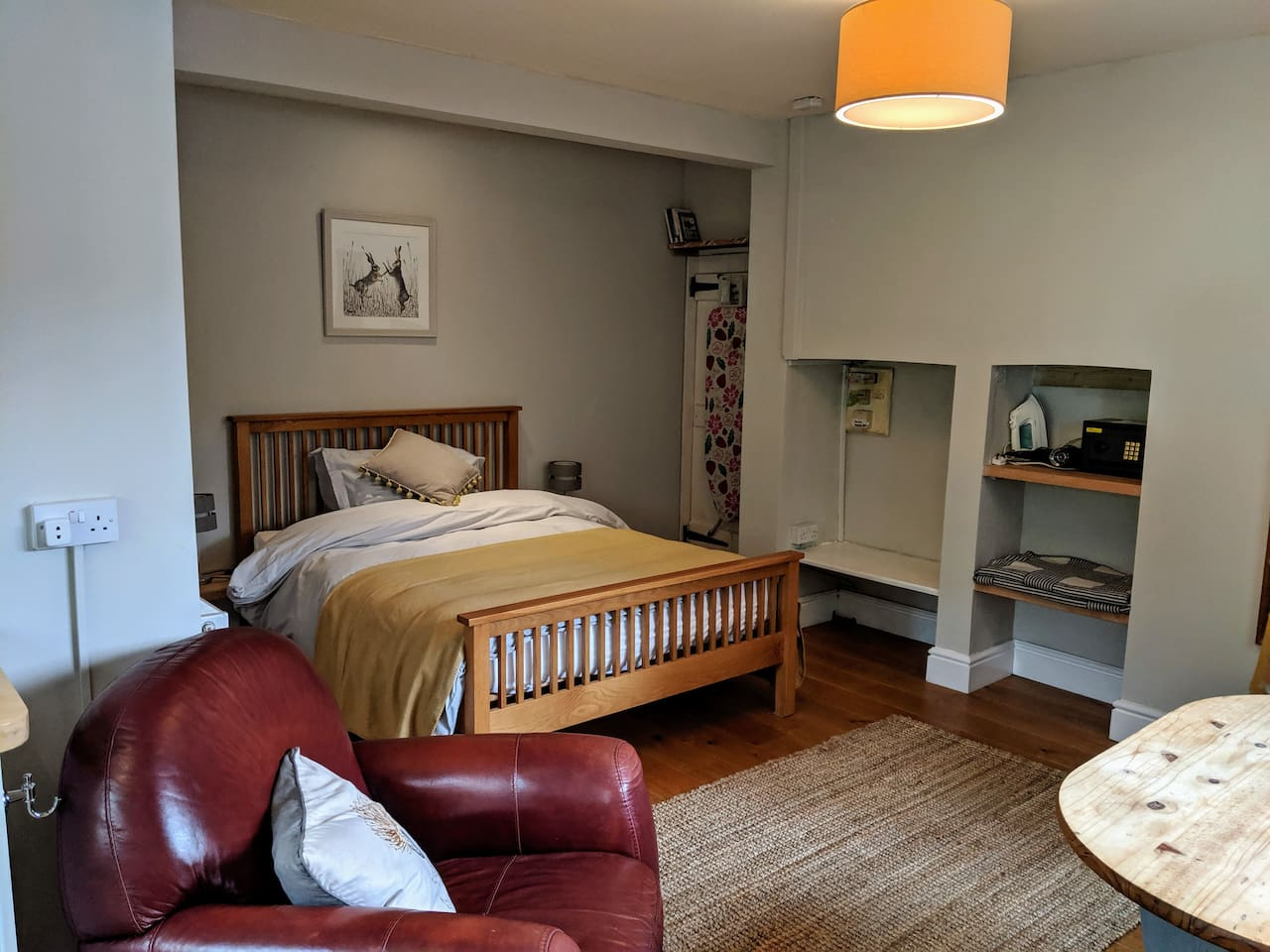 Double bed tucked away from the kitchen area.  100% cotton bed linen for a comfortable night's sleep