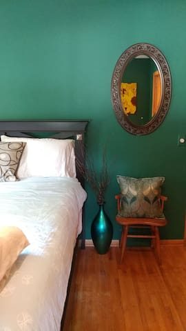 The cozy green guest room