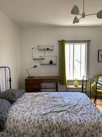 Stylish, quiet room with bright sunlight and private bathroom and kitchenette.
