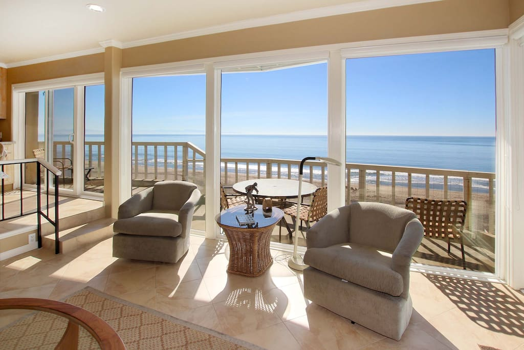 Wall-to-wall windows boast incredible views of Monterey Bay from the main living area.