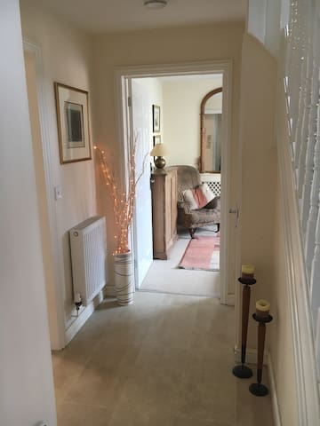Entrance hall leading to the guest sitting room with T.V.