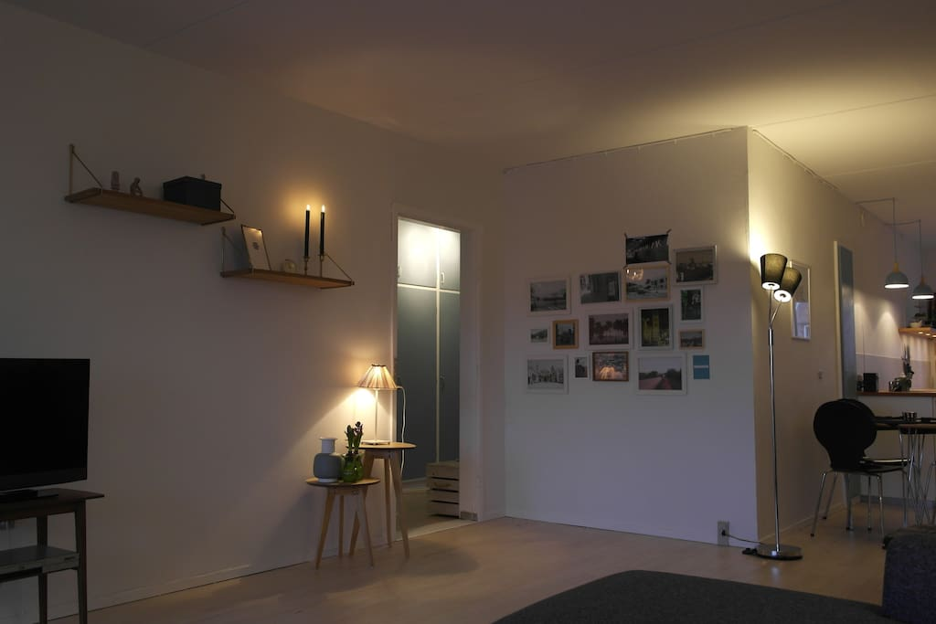 Living room, kitchen & balcony in candle light - Danish 'hygge'