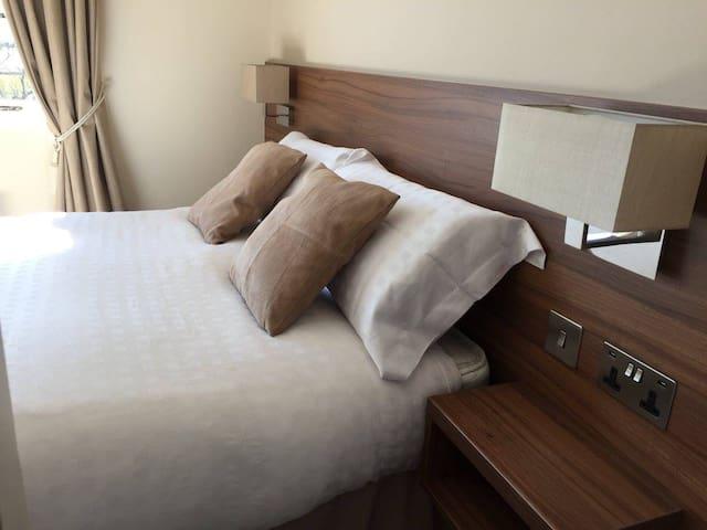 Deluxe bedroom with private en-suite bathroom.