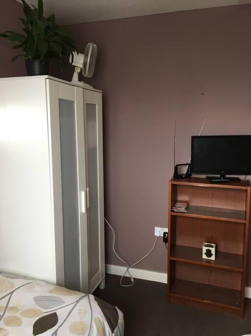 Double wardrobe space, shelf space and fan