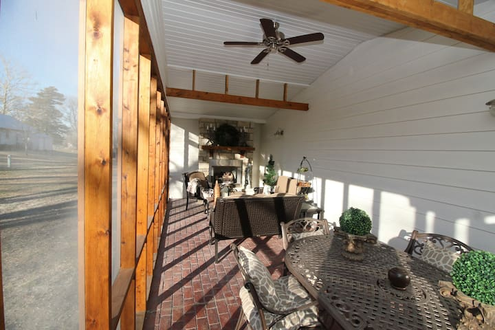 Spacious Screened-In Outdoor Living Room with Fireplace