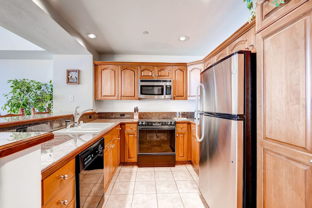 The 4 Bedroom Condo features a fully-equipped kitchen