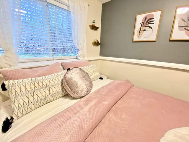 """Your private, cozy bedroom comes equipped with a queen bed with 4"""" memory foam topper, smart TV with Prime, Netflix, and more, full closet, and desk/workspace."""
