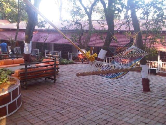 Valley facing resort - Sun n shade - Matheran