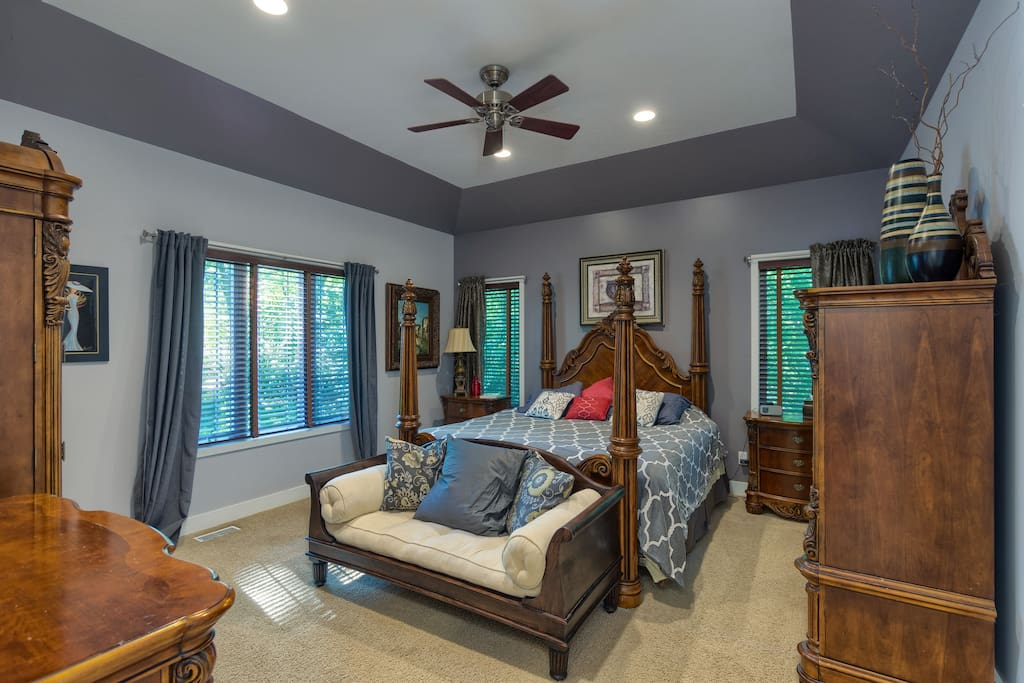 Beautifully decorated main floor master with a very comfortable king size bed and ample storage