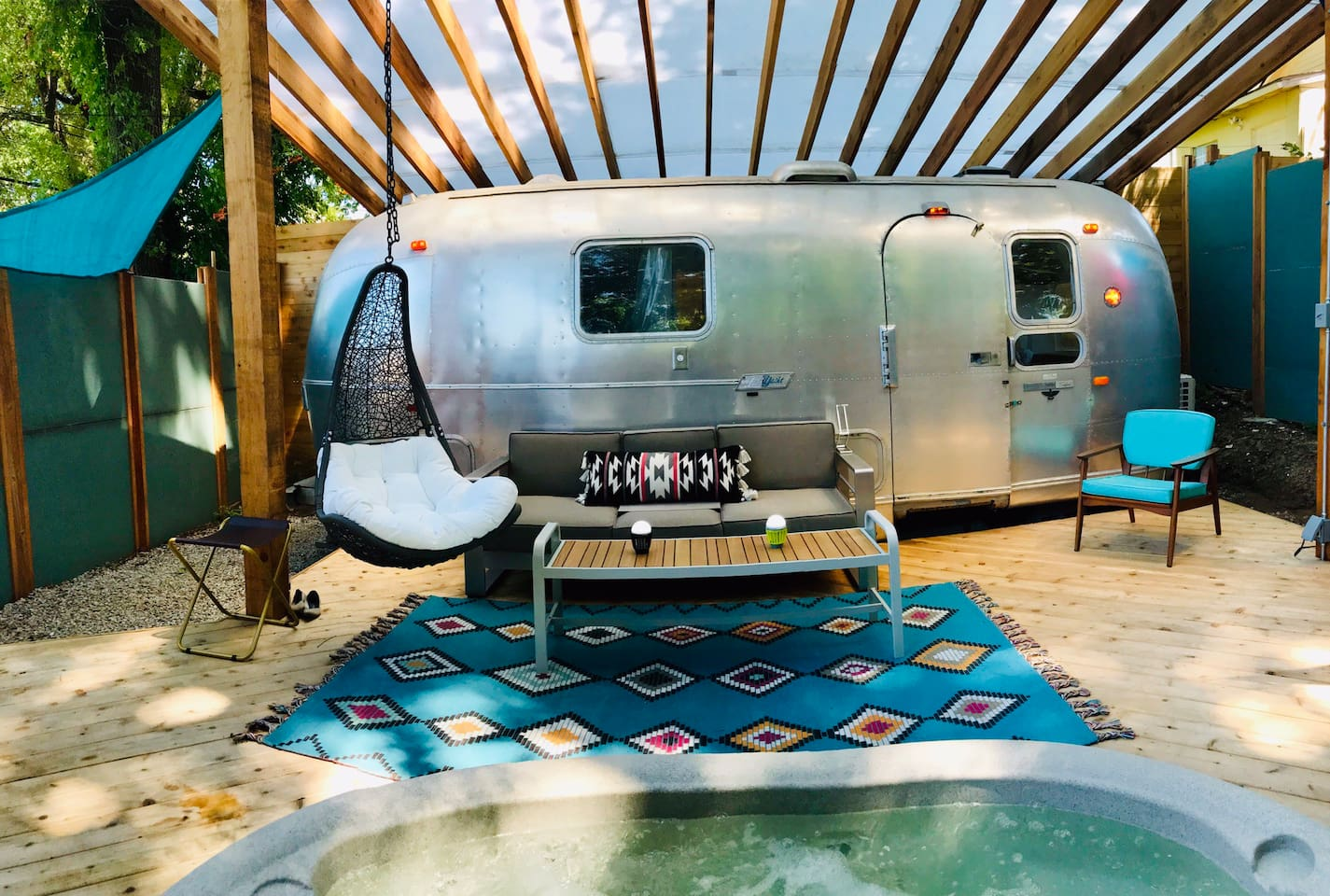 Welcome to our Modern Airstream TinyHouse! It comes with a hot tub, high end kitchen and bathroom, and all the charm you can handle!