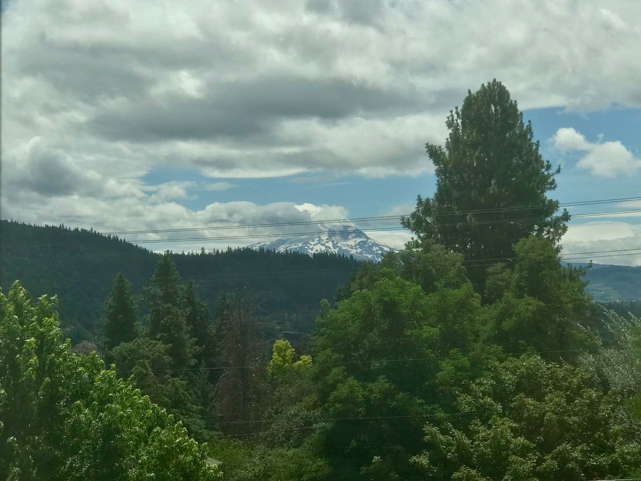 Clouds hover around Mt. Hood's summit. Minutes later the views change again..it's another beautiful day in the Gorge !