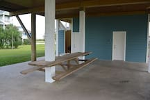Awesome built in picnic table under the deck. Notice outdoor shower entrance
