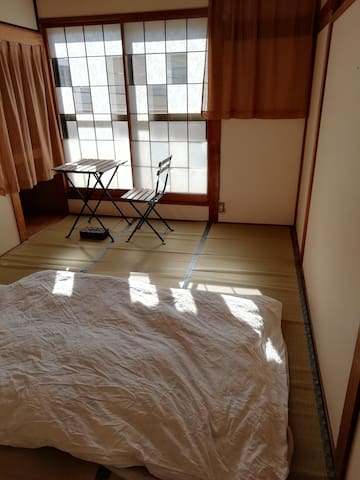 In a quiet Japanese style room that is so fantastic with paper sliding door & thick iron door preventing heavy rain or storm.