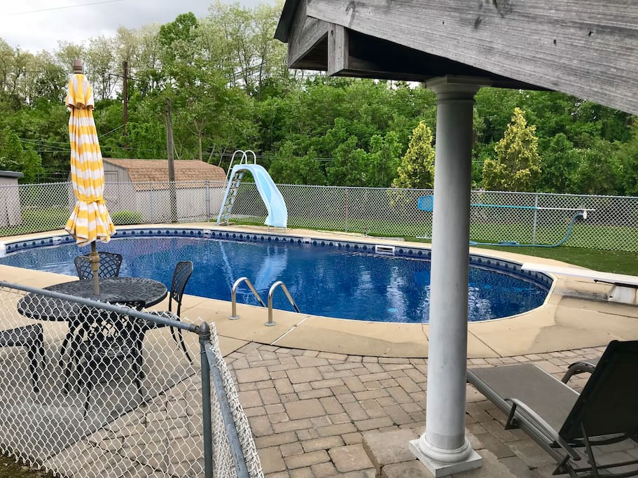 Pool with diving board, slide and plenty of poolside seating