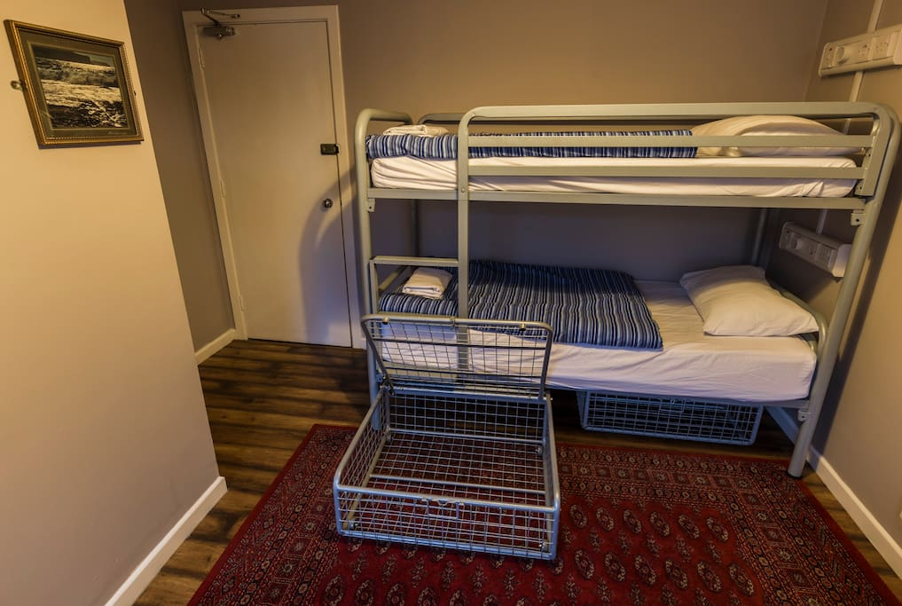 Bunk beds with individual lockers (locks not provided)