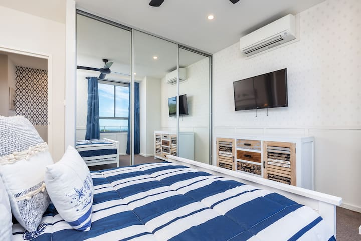 Bedroom 2 also features an air conditioning unit, ceiling fan and a TV.