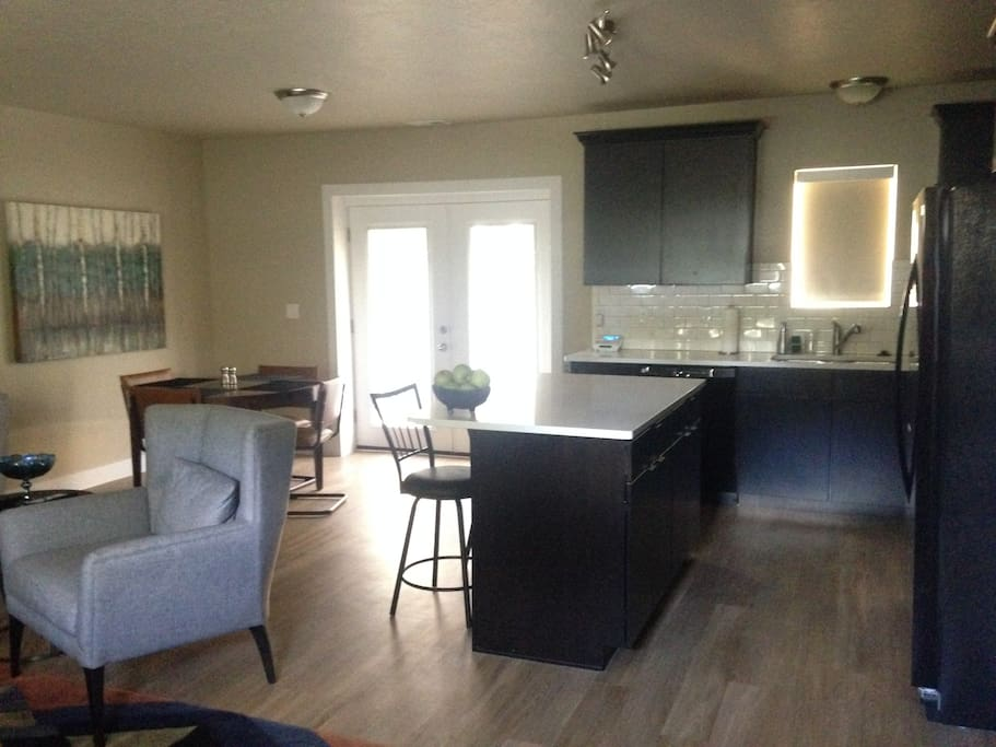 As you walk in the front door.  Kitchen straight ahead, living room to your left, and dining area to the left of the kitchen.  Nice big open space