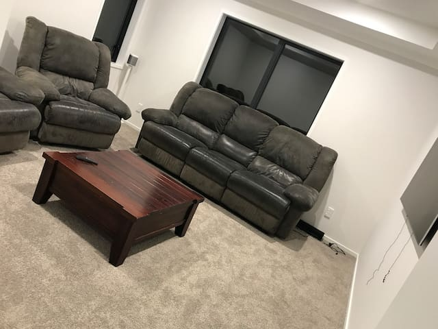 Seperate lounge with 65 inch tv with Netflix