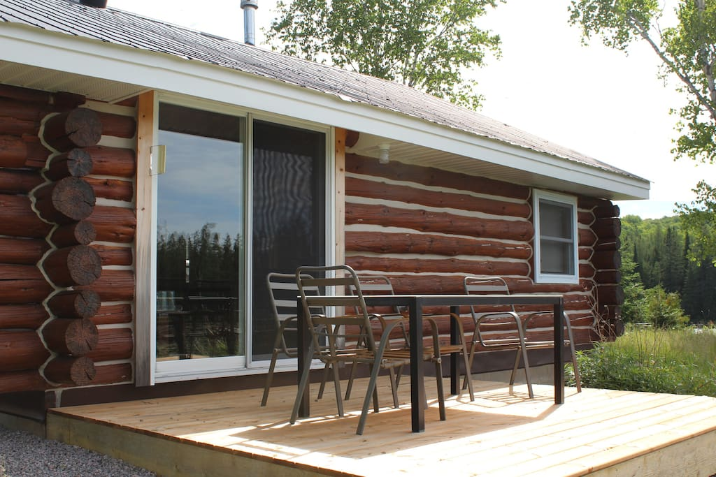 Patio doors lead to a secluded deck with table and chairs. Imagine having your meals and watching the moose move majestically though the water and along the shore while sipping a drink!