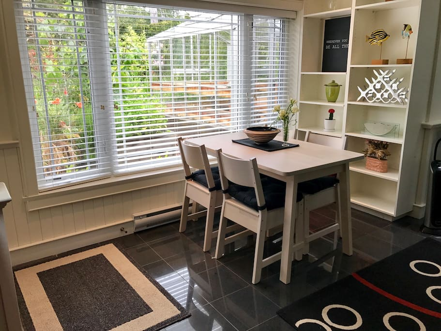 Kitchen seating area with garden view.