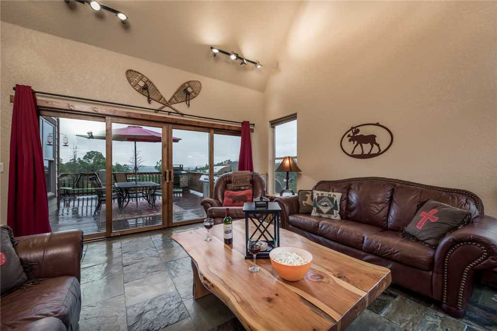Easy Access - The living room provides quick and easy access to the outside deck where you can sit and enjoy the cool breeze and share stories with a friend.