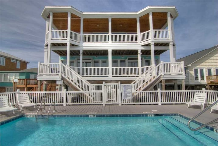The Hideaway B: A Gorgeous 5 Bedroom Oceanfront Duplex, with a Shared Pool, a Walkway to the Beach, and Elevator Access.