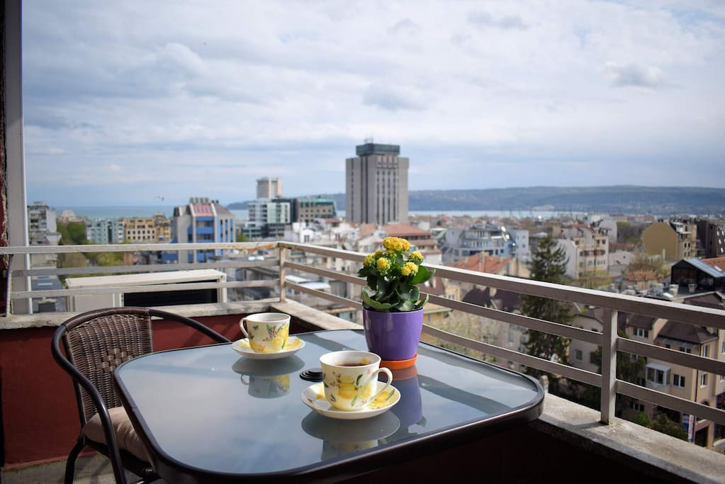Stunning sea and city view with a cup of tea