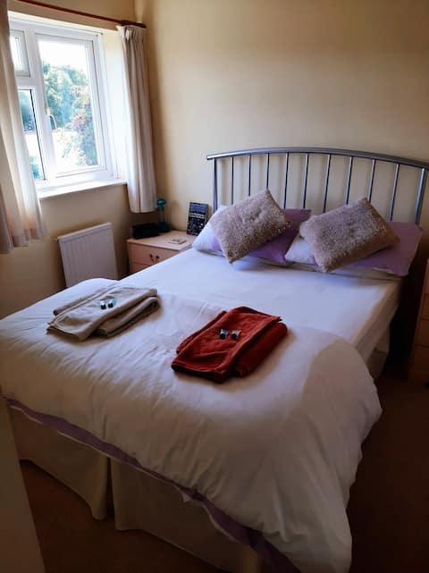 Inviting double bedroom in Charminster, Dorchester