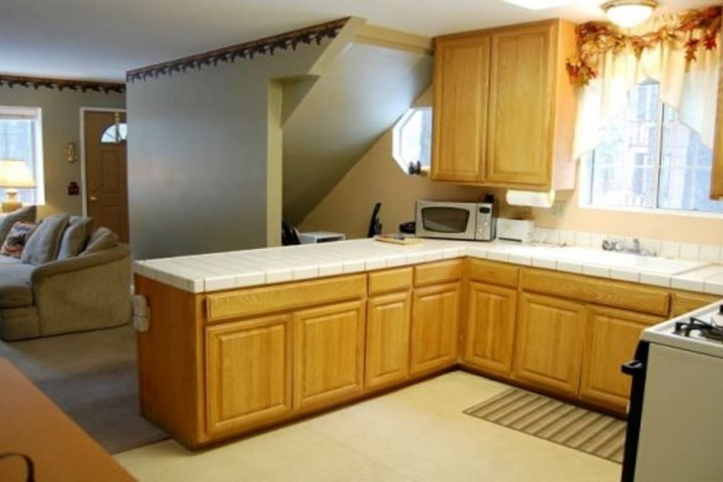 Fully Stocked Kitchen with Table that Expands