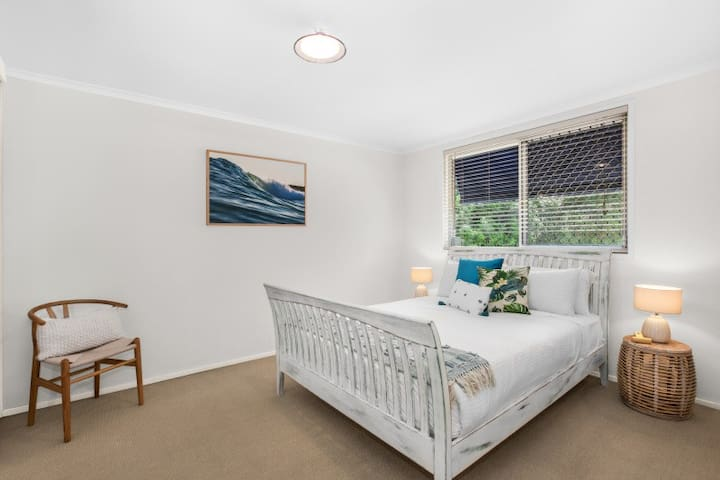 The naturally-lit master bedroom comes complete with a comfortable queen bed and is ideal for a couple