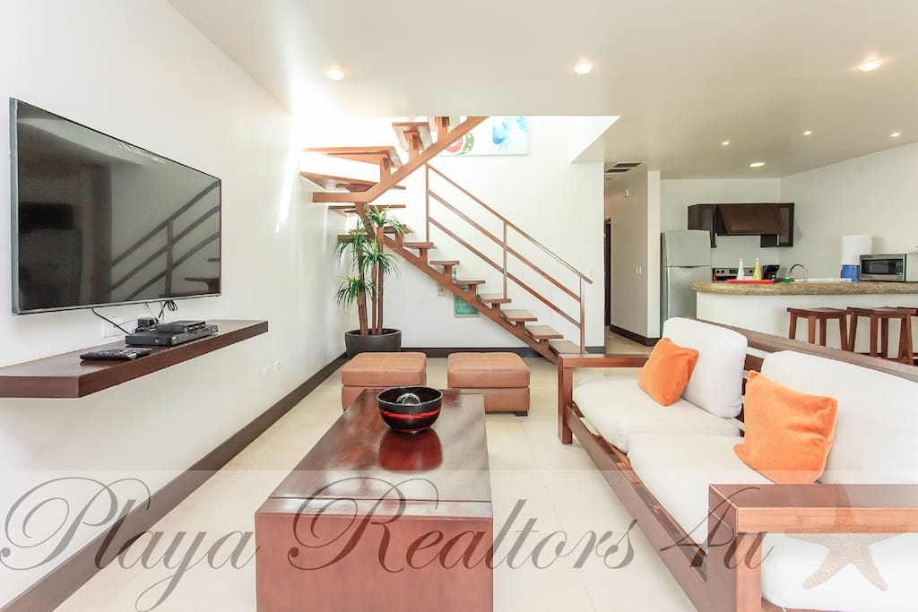 Living Room/Stairs to Private Pool